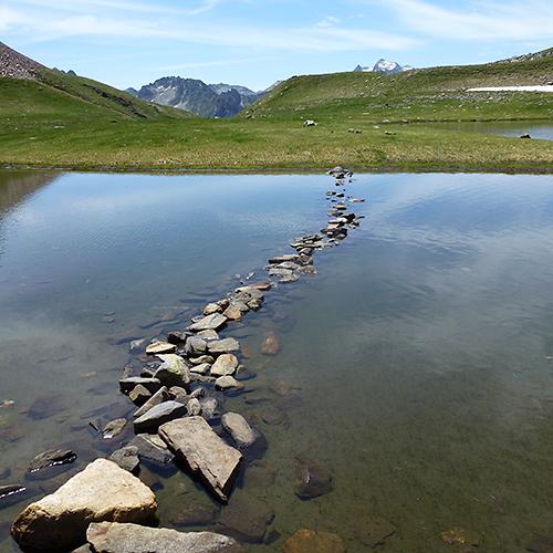 Pyrenees national park lake stepping stones
