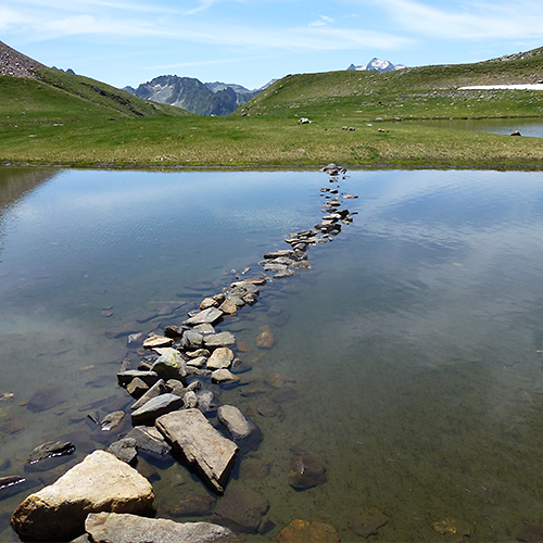 Pyrenees national park lake stepping stones